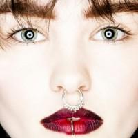 Septum piercing and lip piercing